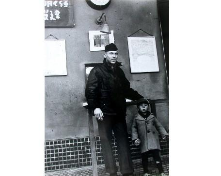 A U.S. navy soldier and a child